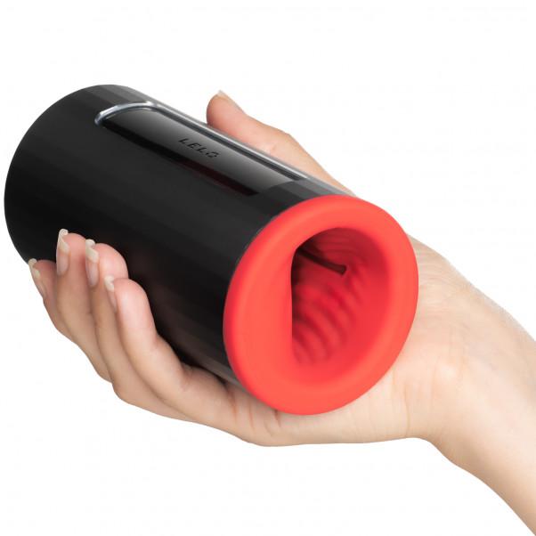 LELO F1S V2 Red Pleasure Console Masturbator Produktbillede med hånd 50